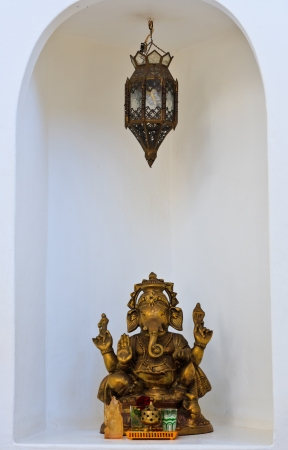 Golden Hindu God Ganesh on the wall white  photo