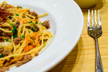 Spagetti with kimchi mixed minced meat beef  photo