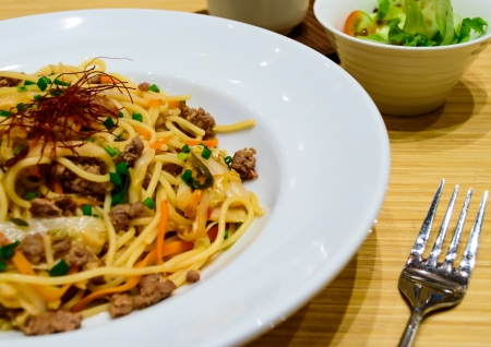 Spagetti with kimchi mixed minced meat beef and Japanese salad  photo