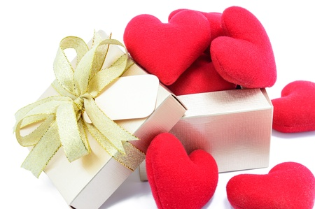 Golden gift box and red heart on white background  photo