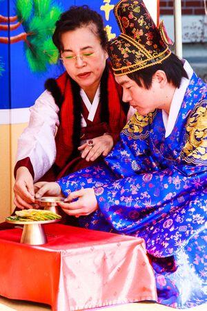 folk village: Daegu - January 17   A performance of the Traditional Wedding of Thananya   Park Jin Hyun at Korean Folk Village on January 17, 2010 in Daegu, South Korea  Editorial
