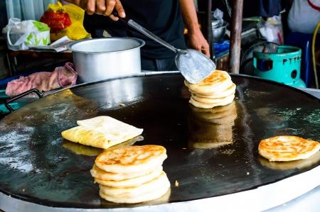 Make Indian Food Gourmet Southern Flat Bread Fry Pan roti  Stock Photo