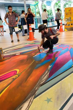 Bangkok - March 3   An artist  Tony Cuboliquido  during drawing and painting his 3D artwork in Living Arts @ Ratchaprasong Street of Arts Street of Fun on March 3, 2013 at Ratchaprasong, Bangkok, Thailand  Stock Photo - 18193858