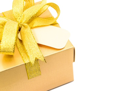Golden gift box on white background