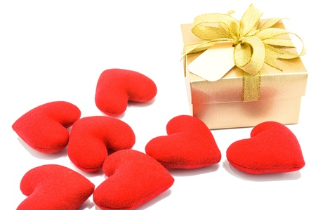Golden gift box and red heart on white background  Stok Fotoğraf