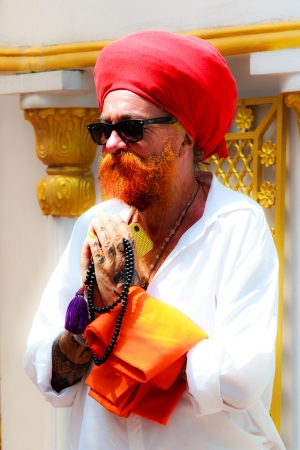 Bangkok - March 17   Sikh devotee with red turban at Gurdwara Siri Guru Singh Sabha on March 17, 2013 in Bangkok, Thailand  Worldwide there are about 25 million Sikhs