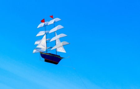 The kite shape of Brig on the blue sky background  photo