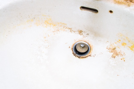 Dirty white ceramic sink never been cleaned