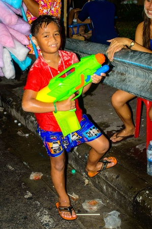 Bangkok - April 13    An unidentified thai boy joins Thai new year celebrations near Khao San Road on Apr 13, 2013 in Bangkok, Thailand  Thailand  The new year of Thai or Songkran, celebrations are from 13 to 15 April  Editorial