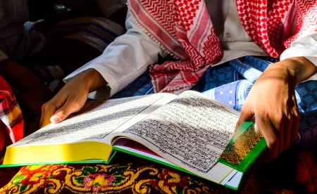 A Young Muslim Boy reading the Holy Quran Stock Photo - 19120462