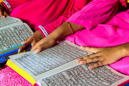 recite: A Young Muslim Girl reading the Holy Quran