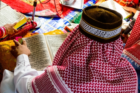 A Young Muslim Boy reading the Holy Quran  Stock Photo - 19120465