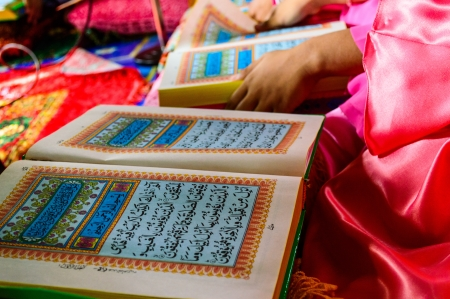 A Young Muslim Girl reading the Holy Quran