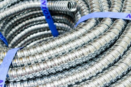 conduit: Close up Metal cable protection conduit electric line  Stock Photo