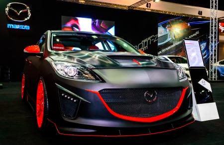 BANGKOK - JUNE 20   Mazda 3 on display at Bangkok International Auto Salon 2013 Exciting Modified Car Show on June 20, 2013 in Bangkok, Thailand