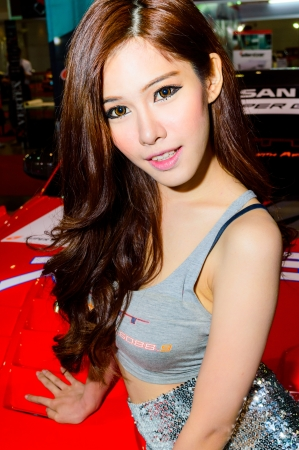 BANGKOK - JUNE 20   Female presenters model at Bangkok International Auto Salon 2013 Exciting Modified Car Show on June 20, 2013 in Bangkok, Thailand  Stock Photo - 20449411