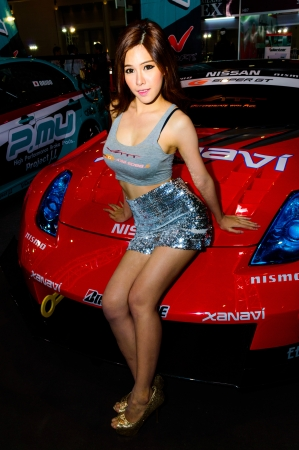 BANGKOK - JUNE 20   Female presenters model at Bangkok International Auto Salon 2013 Exciting Modified Car Show on June 20, 2013 in Bangkok, Thailand  Stock Photo - 20449413