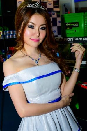 BANGKOK - JUNE 20   Female presenters model at Bangkok International Auto Salon 2013 Exciting Modified Car Show on June 20, 2013 in Bangkok, Thailand