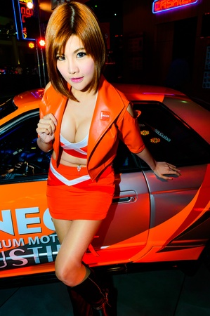 BANGKOK - JUNE 20   Female presenters model at the ENEOS booth during at Bangkok International Auto Salon 2013 Exciting Modified Car Show on June 20, 2013 in Bangkok, Thailand  Stock Photo - 20449387