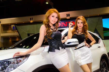 BANGKOK - JUNE 20   Female presenters model at the Honda booth during at Bangkok International Auto Salon 2013 Exciting Modified Car Show on June 20, 2013 in Bangkok, Thailand  Stock Photo - 20449396