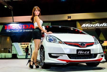 BANGKOK - JUNE 20   Female presenters model at the Honda booth during at Bangkok International Auto Salon 2013 Exciting Modified Car Show on June 20, 2013 in Bangkok, Thailand  Stock Photo - 20449383