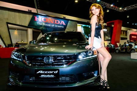 BANGKOK - JUNE 20   Female presenters model at the Honda booth during at Bangkok International Auto Salon 2013 Exciting Modified Car Show on June 20, 2013 in Bangkok, Thailand  Stock Photo - 20449394