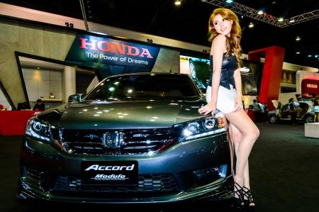 BANGKOK - JUNE 20   Female presenters model at the Honda booth during at Bangkok International Auto Salon 2013 Exciting Modified Car Show on June 20, 2013 in Bangkok, Thailand