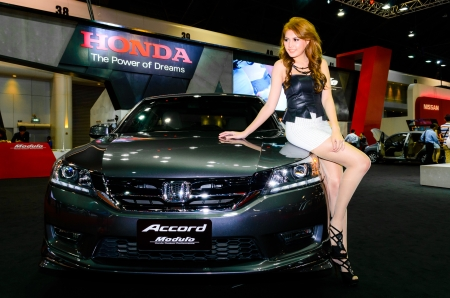 BANGKOK - JUNE 20   Female presenters model at the Honda booth during at Bangkok International Auto Salon 2013 Exciting Modified Car Show on June 20, 2013 in Bangkok, Thailand