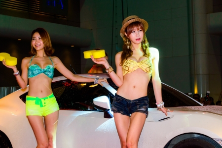 BANGKOK - JUNE 20   Show Beautiful bikini models wash a car at Bangkok International Auto Salon 2013 Exciting Modified Car Show on June 20, 2013 in Bangkok, Thailand  Stock Photo - 20449418