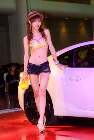 BANGKOK - JUNE 20   Show Beautiful bikini models wash a car at Bangkok International Auto Salon 2013 Exciting Modified Car Show on June 20, 2013 in Bangkok, Thailand  Stock Photo - 20449386