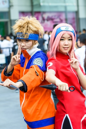 BANGKOK - AUGUST 31   Cosplayer as characters Naruto and Sakura from Naruto in Japan Festa in Bangkok 2013 on August 31, 2013 at Central World, Bangkok, Thailand  Naruto is a famous on Manga and Anime in many country