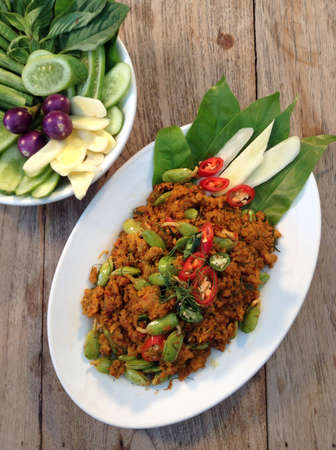 Fried Pork with Yellow Curry Paste and Reng Beans Parkia Timoriana