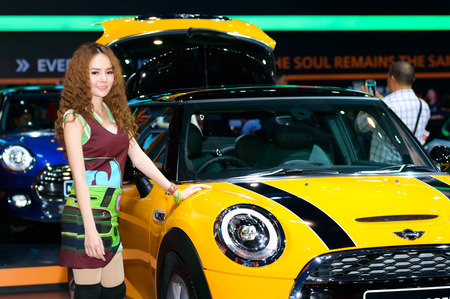 BANGKOK - MARCH 27   Female presenters model at the Mini Cooper booth during at The 35th Bangkok International Motor Show - 'Beauty in the Drive