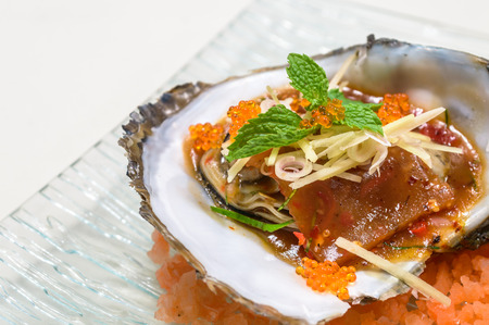 Baked oyster shell spicy sauce with egg shrimp  Stock Photo