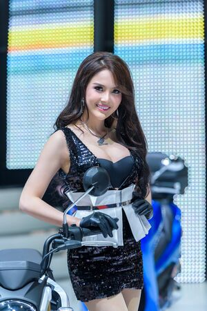 easing: BANGKOK - MARCH 24 : Unidentified Model with Honda Motorcycle on display at The 36th Bangkok International Motor Show