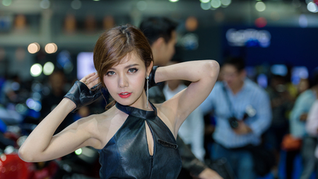 no boundaries: BANGKOK - MARCH 22 : Unidentified model with Triumph motorcycle on display at The 37th Bangkok International Motor Show : No Boundaries Mobility on March 22, 2016 in Bangkok, Thailand.