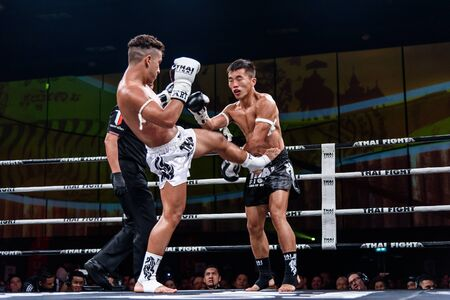 lou: NONTHABURI - JULY 23 : Lou Jim of China and Jean Nascimento of Brazil in Thai Fight Proud to be Thai on July 23, 2016 at West Gate Hall, CentralPlaza WestGate, Bang Yai, Nonthaburi. Editorial