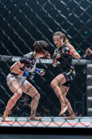 BANGKOK - MARCH 11 : Angela Lee of Singapore and Jenny Huang of Chinese Taipei in One Championship One : Warrior Kingdom on March 11, 2017 at Impact Arena, Muang Thong Thani, Bangkok, Thailand Editorial