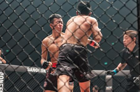 BANGKOK - MARCH 11 : Sagetdao Petpayathai of Thailand and Kelvin Ong of Malaysia in One Championship One : Warrior Kingdom on March 11, 2017 at Impact Arena, Muang Thong Thani, Bangkok, Thailand Editorial