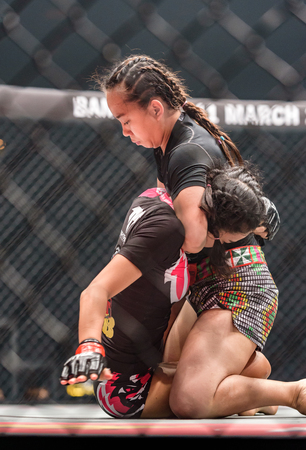 BANGKOK - MARCH 11 : Rika Ishige Tiny Doll of Thailand and Audreylaura Boniface of Malaysia in One Championship One : Warrior Kingdom on March 11, 2017 at Impact Arena, Muang Thong Thani, Bangkok, Thailand Editorial