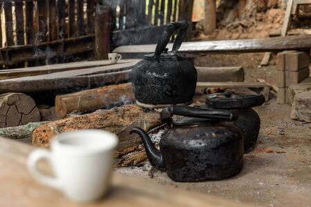 Burned kettle for black coffee in a small mountain village in Thailand. (Thai traditional old style coffee) Stock Photo