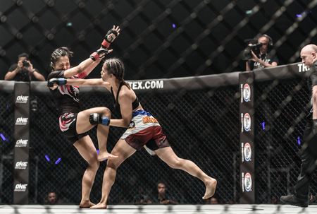 "BANGKOK - December 09 : Rika ""Tiny Doll"" Ishige of Thailand and Rome ""The Rebel"" Trinidad of Philippines in One Championship ""Warrior of The World"" on December 09, 2017 at Impact Arena, Muang Thong Thani, Bangkok, Thailand Editorial"