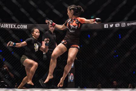 BANGKOK - March 24 : Angelie Sabanal of Philippines and Rika Ishige of Thailand in One Championship : IRON WILL on March 24, 2018 at Impact Arena, Muang Thong Thani, Bangkok, Thailand. Editöryel
