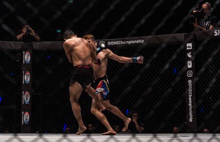 BANGKOK - March 24 : Jeremy Miado of Philippines and Dejdamrong Sor Amnuaysirichoke of Thailand in One Championship : IRON WILL on March 24, 2018 at Impact Arena, Muang Thong Thani, Bangkok, Thailand.