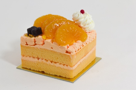 Orange cake decorate with freshcream and butterfly cacao.