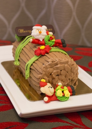 bear berry: Traditional Christmas Yule Log cake decorated with santa bear and fiower mazipan