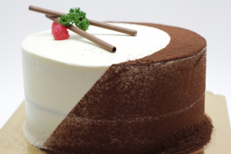 Chocolate cake with Fresh creme and chocolate power photo