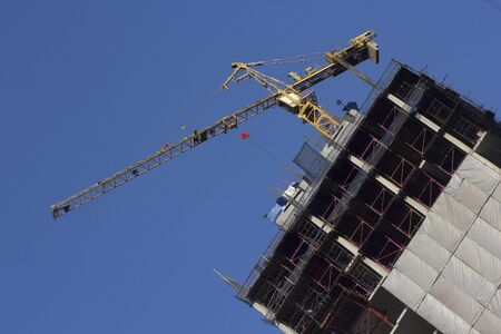 Yellow crane on building  with blue sky Stock Photo - 17404833