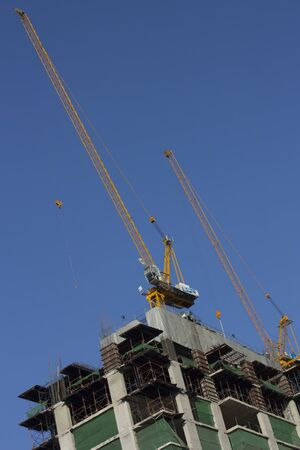 Yellow crane on building  with blue sky Stock Photo - 17404566