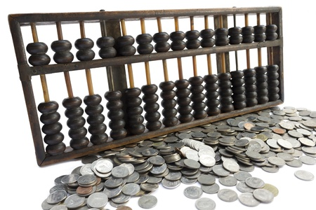 Abacus and coin on white background Stock Photo